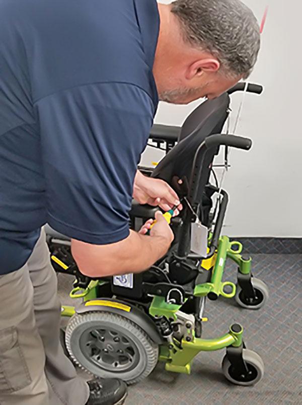 Technician repairing wheelchair